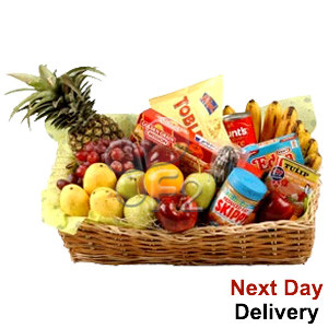 Deliver best wishes to them with a bounty of gourmet food and fruits. This basket packed with a mouth-watering array of seasonal fruits, cheese, pasta, canned goods, chocolates and sausages is sure to be a welcome gift. #food