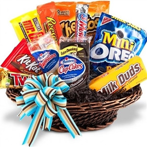A gift basket that is as fun as it is delicious! Filled with delicious snacks and sweets, our popular Junk Food Basket is the perfect gift for students, employees, or anyone who deserves an extra special indulgence. An experienced, local florist will fill #food