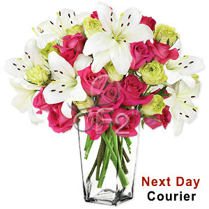Bursting with style, color and extravagance, this luxurious arrangement featuring gorgeous pink and green or yellow roses surrounded by stems of white lilies arranged in a glass vase, will add charm and elegance to your loved ones day. #best