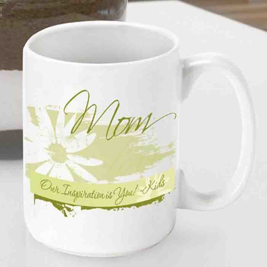 This 15 ounce Mom mug will let her know you care with every sip! Send your Mom a daisy arrangement that will last forever with our Delicate Daisy mom coffee mug. The whimsical design of this mug is just right for a springtime Mother's Day gift. Make sure #mug