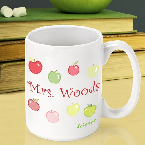 Customize a ceramic mug for a favorite teacher! Nothing makes a teacher happier than apples! Our Happy Apples custom mug is a sweet way to thank that special teacher. This mug will look great in the teacher's lounge or on a desk. The coffee cup holds 15 #mug