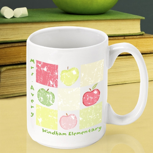 Now a great teacher can enjoy an apple every day! Be sure to surprise a teacher with an apple at the end of the school year! Our Patchwork Apples mug is too cute to pass up and will look great sitting on a teacher's desk. This white ceramic mug has a pat #mug