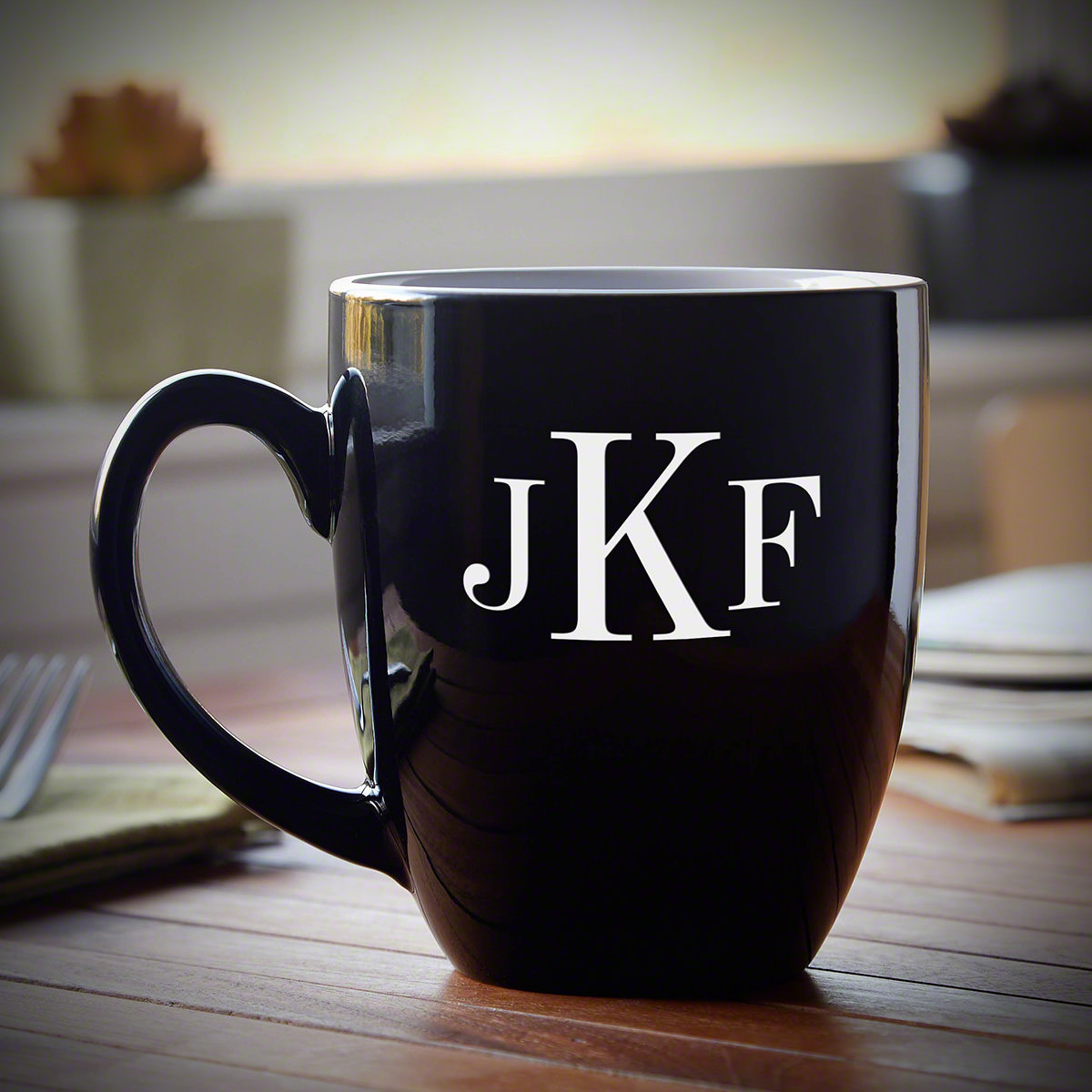 Sleek and modern, made from quality ceramic, this Classic Monogram personalized coffee mug is a first-class gift for any occasion. Featuring a glossy black exterior, we custom engrave each one to order with up to three initials of your choice. The inside #mug