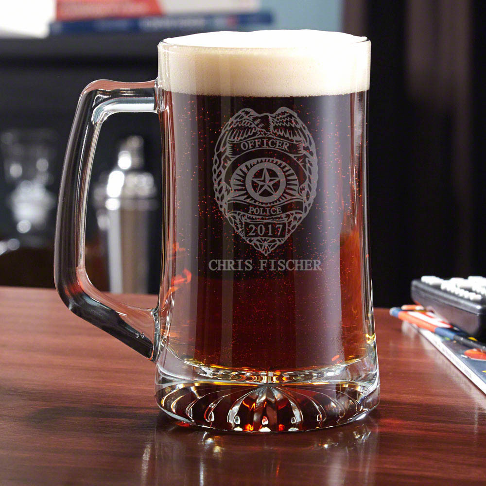 Give some authority to your home bar glassware collection with our Police Badge personalized beer mug. Heavy duty and right down to business, this mug is perfect for enjoying a nice brew after a long day on the job. Engraved with a traditional police badg #mug