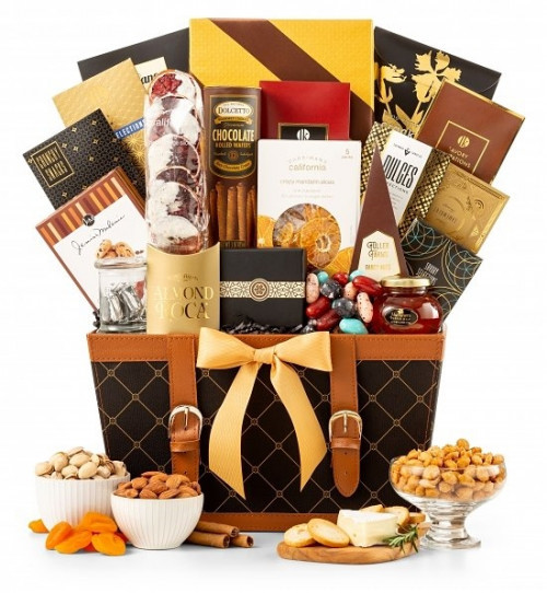 A true treasure trove of our finest gourmet foods! A true treasure trove of our finest gourmet foods! Surprise a loved one with this elegant gift chest all dressed in gold! Full of gourmet sweets and treats, this gift basket proves the perfect choice for #gift