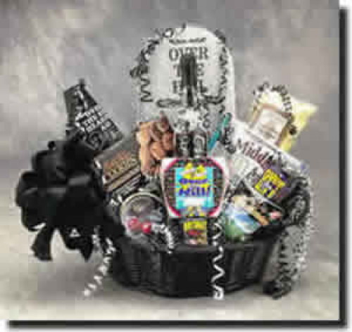 That over-the-hill birthday will be lots of fun when the Over The Hill gift basket arrives. A tombstone towers over cookies, over the hill pills, an over the hill mug, lots of goodies as well as the Victims Guide to Birthdays book. Don't miss the over the #gift