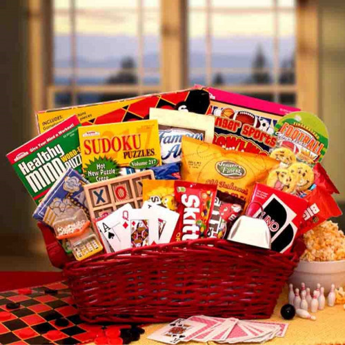 A basket filled with great games and sweet snacks for the entire family. Fun times here we come! Send this fun filled and sweet treats gift basket to someone special today. A unique gift appropriate for many occasions we've included an assortment of fun a #gift