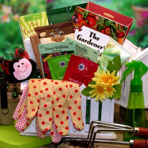 Garden planter loaded with seeds, tools, and gourmet treats: Have a wonderful gardener in your life? Send them this adorable garden planter filled with gardening treats and tools. We've included garden seeds, a mini wind chime, a gardening knee pad and mo #gift