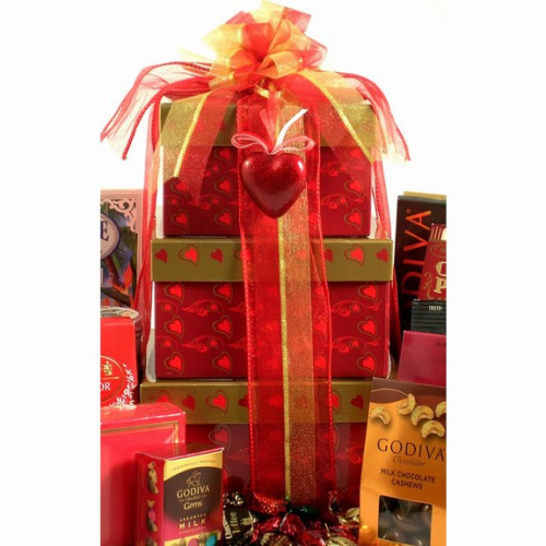 This Valentine gift tower will treat them to some of our most popular gourmet gifts in this eye catching three-tier gift tower! It includes a heart gift tie. Contents of the top box include: S'more Bark, Cranberry Toffee Chocolate Bark, Triple Chocolate T #gift