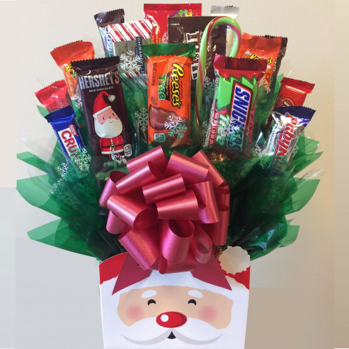 A Santa box holds a bouquet of full and fun size candy bars and candies staged to look like a flower arrangement. Santa Claus has arrived with a sleigh full of candy favorites! Our Santa Bouquet is perfect for everyone on your holiday gift list. This Sa #gift