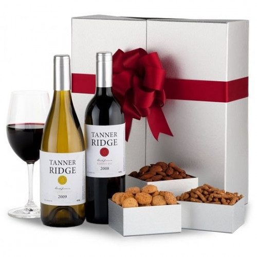 An elegant offering of fine wine & food is sure to make any occasion memorable. Included is a bottle of Sycamore Lane California Cabernet Sauvignon & Chardonnay with an array of delicious finger foods, shipped in a one-of-a-kind wine box. #gift