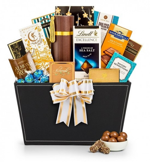 A generous display for the chocolate lover on your gift list! Tempt and delight the chocolate lover on your list with a decadent array of premium confections! Beautifully presented in an elegant willow attache, our Chocolate Temptations Gift Basket will b #gift