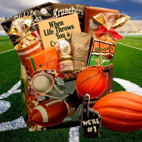 A Great Gift For any Sports Fan! A great gift basket for the avid sports fanatic! Loaded with treats for the participant, or the fan. Everyone will enjoy all the cool treats and gifts jammed in this one! #gift