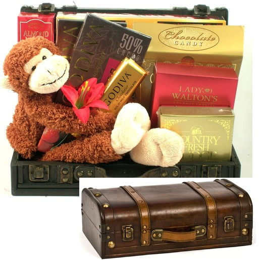 This stylish wooden trunk arrives with a selection of some our most sought after gourmet goodies along with one very cute stow-away, Mojo, an adorable plush monkey with Velcro on his paws, making him perfect for hugging! Contents include: Buttercrunch Tof #gift