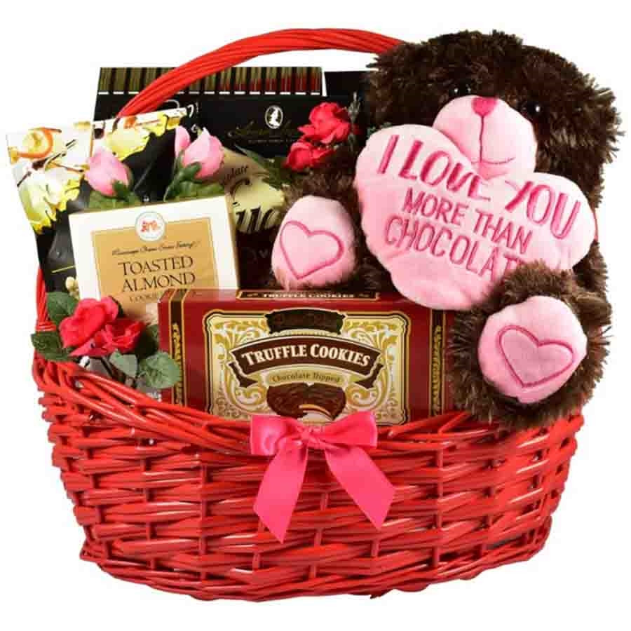 This extra large gift basket arrives in the company of an over-sized plush pup too cute to resist! Mouthwatering sweets make this gourmet basket a standout gift. #gift