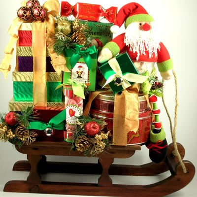 Dashing Through The Snow Deluxe Christmas Gift Basket Sleigh totes gourmet sweets, crackers, sausage and cheese topped with a whimsical Santa. Send this beauty dashing through the snow to their doorstep for Christmas! This over-sized gift features a wonde #gift
