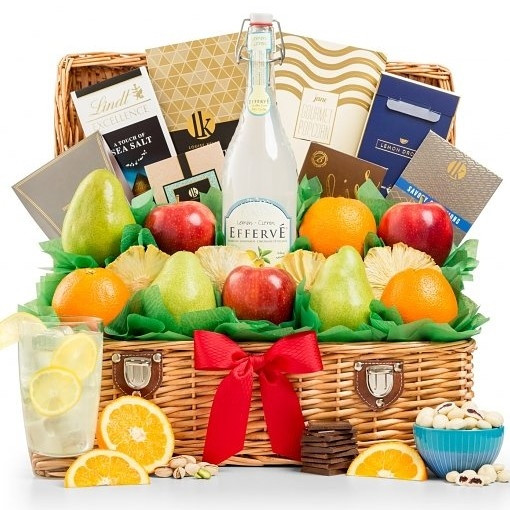 Send the delicious gift of orchard-fresh fruit combined with an assortment of gourmet delicacies. A picnic-style hamper holds premium California Navel Oranges, D'Anjou Pears, and Fuji Apples, along with Pacific Gold Mixed Nuts (nutcracker included), Hot P #gift