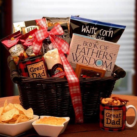 This basket starts with a Book of Father's Wisdom and He's A Great Dad Coffee Mug. It is loaded with sausage, cheese, snacks and sweet treats. #gift