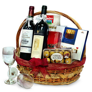 This striking Hamper Tower is one of our very popular gifts. With its striking appearance and gourmet produce, it is perfect for a person who loves wine and chocolates. All the ingredients for a gourmet evening, 2 Bottles of Red wine, Loacker Quadratini C #gift