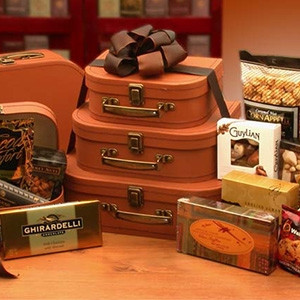 A great gift for your favorite traveler! The 3 faux-leather suitcases allow your loved ones to take their treats with them - plus they can be used long after the goodies are gone! Contents Include: 3 pc Faux Leather Suitcases, Tomato Basil Crackers, Cocoa #gift
