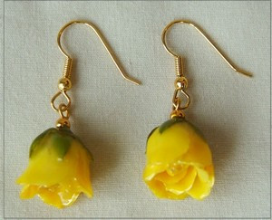 Miniature Yellow roses have been preserved in a clear lacquer finish and trimmed in gold. Rose earrings make great jewelry gifts. Check out our gold rose jewelry line for more unique gift ideas. #gift