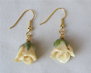 Original Rose Jewelry! These genuine white mini rose earrings will enhance her beauty. The miniature white roses have been preserved in a clear lacquer finish to allow them to be everlasting. They are trimmed in gold using a similar process to our gold ro #gift
