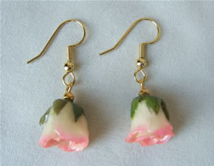You're Sure To Dazzle Her with This Real Rose Jewelry! These genuine cream to pink mini rose earrings will enhance her beauty. The miniature cream and pink roses have been hand preserved in a clear lacquer finish to allow them to be everlasting. They are #gift