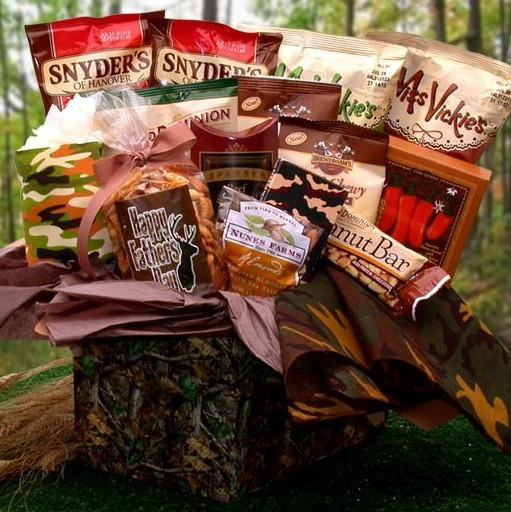 This camo themed gift box starts with a camo drink koozie, playing cards and bandana. It is then topped with sausage, snacks and sweets. #gift