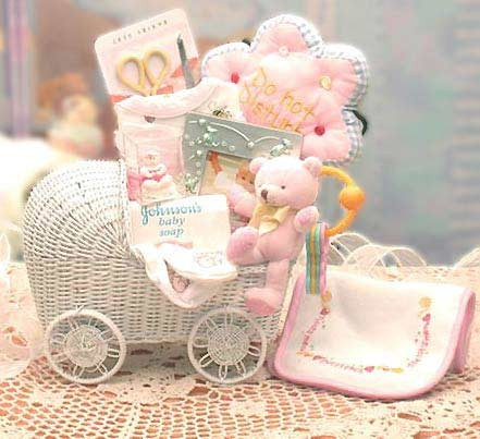 A Great Gift for New Baby Boy! This is a Great Gift for your New Bundle of Joy! Our White Wicker Baby Carriage is stuffed with all the necessities that baby will need along with a Soft Plush Miniature Teddy Bear. Mom & Dad will Love this! Blue Motif #gift