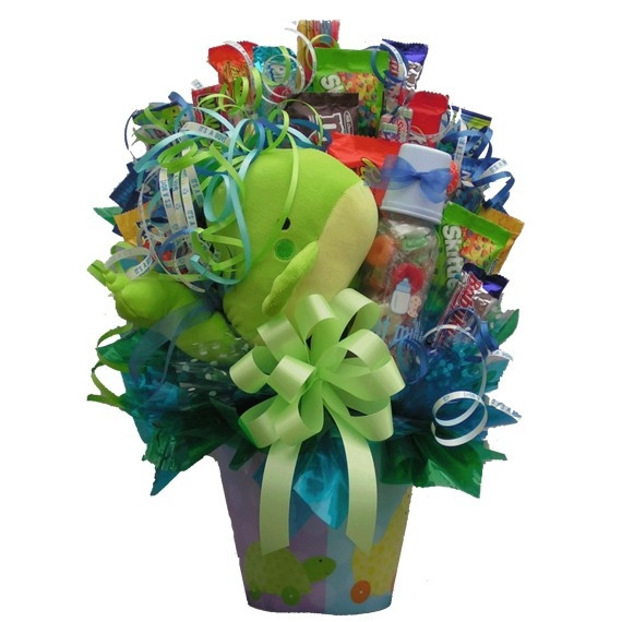 A sweet and tasty bouquet to celebrate their sweet newborn! Welcome the newest addition to their family and say congratulations to the new parents with a New Baby Candy Bouquet. This adorable arrangement features a stuffed animal, baby bottle and lots of #gift