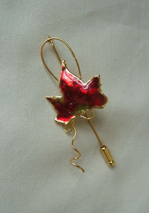 For the nature lover a miniature autumn red maple leaf has been picked at just the right time and then preserved in lacquer and trimmed with just the right amount of 24K gold to make an autumn red Maple Leaf Pin. This process is the same as the one used f #gift