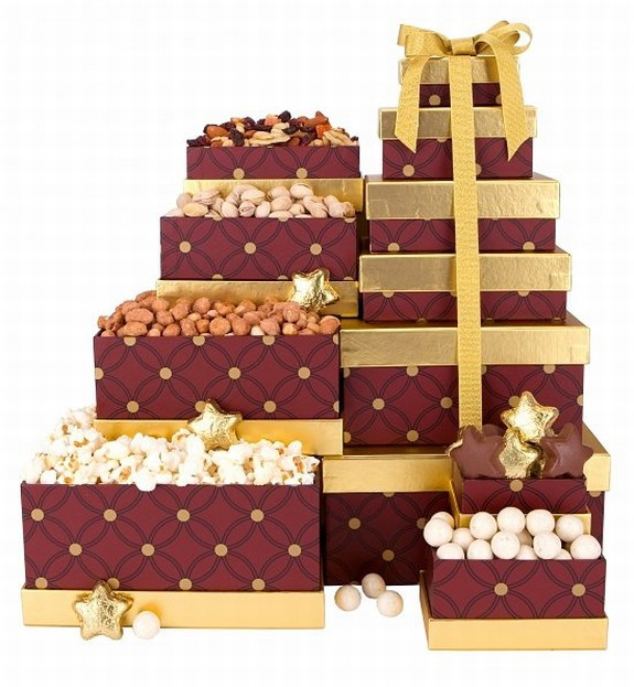An elegant stack of delicious snack surprises. An elegant holiday tower of six delicious snack surprises! These keepsake boxes are packed with favorite Christmas snacks and make the perfect holiday party hostess gift! You can certainly check someone off #gift