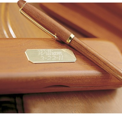 A lovely gift for any graduate or executive! This genuine Rosewood Pen and Case offers style to any executive's office. This pen gift set can also be given as a personalized gift for graduation or birthday gift. Brass plate is personalized with up to two #gift